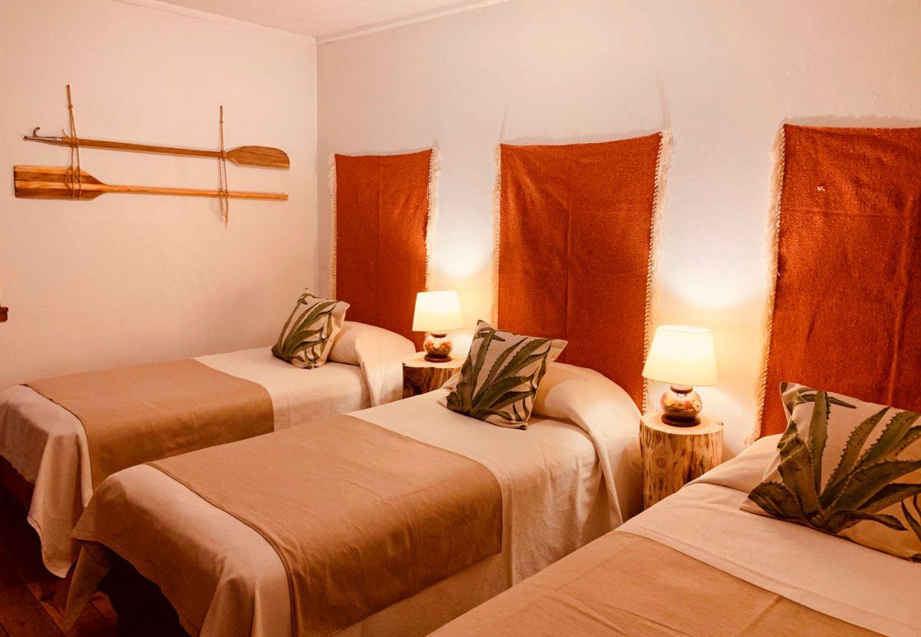 Dormitorio con camas simples BOG Pichi Ruca Villa La Angostura