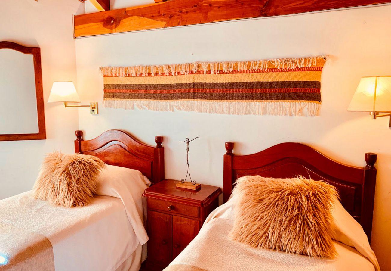 Dormitorio con camas individuales BOG Pichi Ruca Villa La Angostura